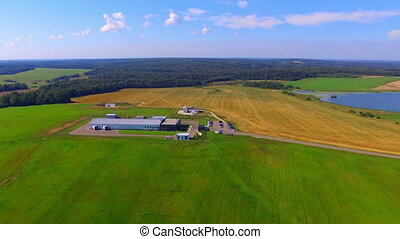Aerial view on modern farm buildings at the field