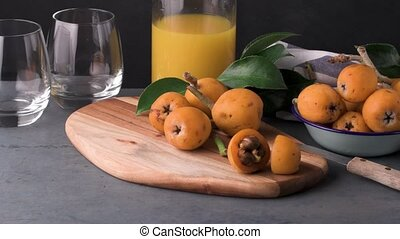 loquats on kitchen counter background.