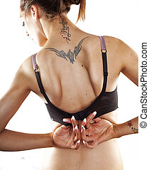 taking off bra - Woman with tatoo taking off bra Isolated...
