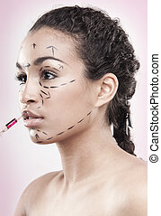 botox - Drawn lines on a mixed colour womans face as marks...