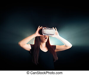 Woman with VR Glasses Headset Enjoying the Virtual Reality...