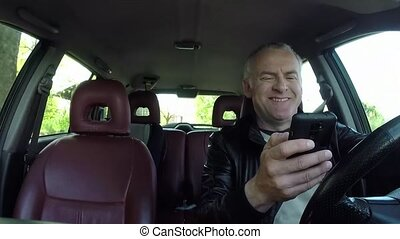 Car Driver Using Smartphone For Email Internet And Driving Car