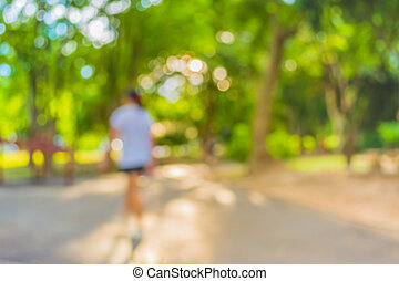 Blur image of people activities in park with bokeh on day...