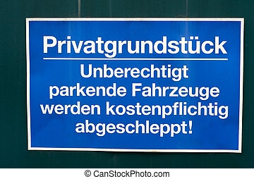 Private plot - sign at a gate with the german words private...