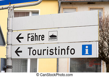 Information sign - Signpost with the german words ferry and...