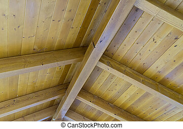 Wooden roof made of beams and boards