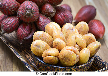 Close-up of Salak or Salacca zalacca tropical fruit in...