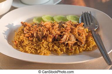 Chicken Biryani with green chutney in dish - image of...