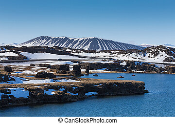 Myvatn volcano over blue lagoon, Iceland winter natural...