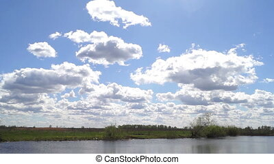 Sky river lake clouds - Time lapse of sun rays emerging...