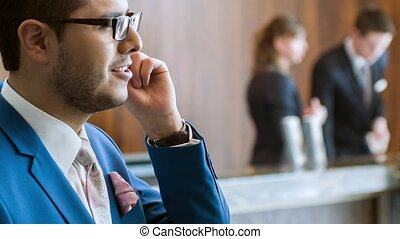 Magnetic office worker talking on phone