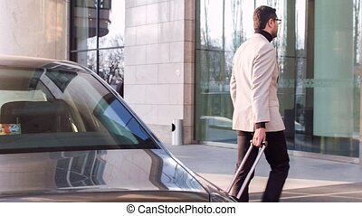 Attractive businessman arriving to hotel - Long trip behind....