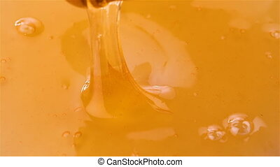 Dripping honey in slow motion