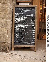 Hand written menu stand on a street corner
