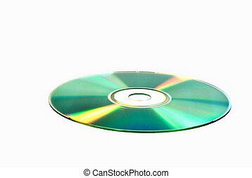 DVD-disk is on the white surface - DVD-disk lies against...