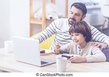 Positive son and father spending time in family circle