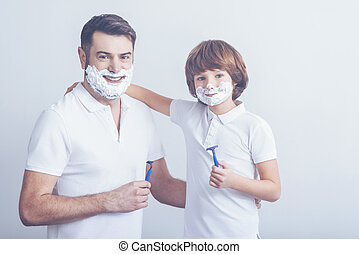 Father teaching son how to shave - Like father, like son....