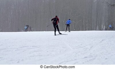 Equipped skiers skiing on piste