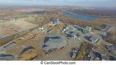 Concrete plant near a big road. Aerial. - Concrete plant...
