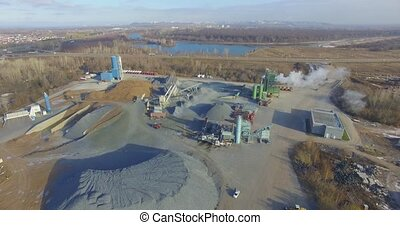 Concrete plant near a big road. Aerial.