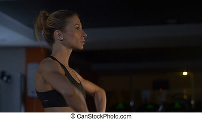 Woman training with the barbell