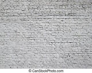 grey brick wall background at day