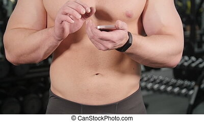 Man Checks Fitness Results Smartphone.Adult Guy Wearing Sport Tracker Wristband Arm