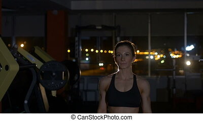 Beautiful fitness woman with lifting dumbbells . Sporty girl...