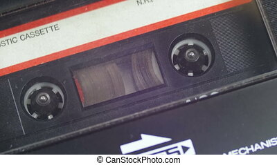Insert an Audio Cassette into a Tape Recorder and Play....