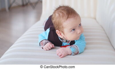 Cute baby lying on the white bed - Cute baby on the white...