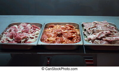 Three types of meat with different marinade sauces and...
