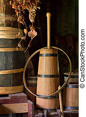 Butter Churn - Old-fashioned wooden butter churn and barrels