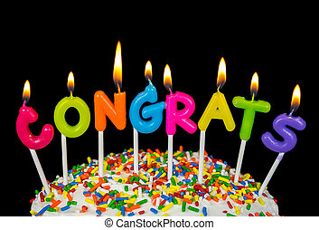 congrats candle on cake - lit congrats candles on white cake...