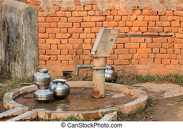 Hand operated water pump - Old hand operated water pump and...