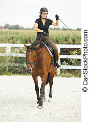 Woman Riding a Horse in Jumper Ring
