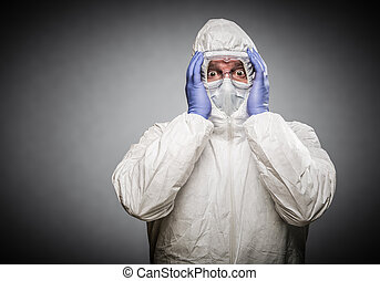 Man Holding Head With Hands Wearing HAZMAT Protective...