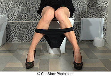 woman legs in toilet - part of the woman who sits on a...