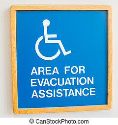 Handicap evacuation warning sign on the wall