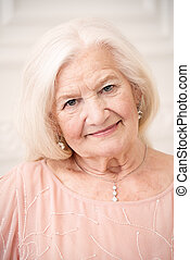 well-being senior woman - Modern well-groomed old woman with...