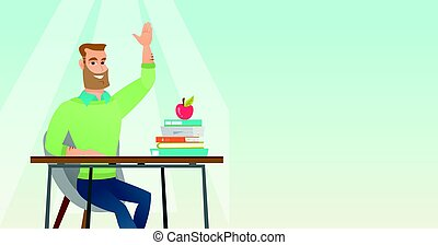 Student raising hand in class for an answer.