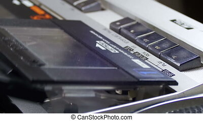 Opening the Cassette Deck, Inserting a Cassette and Playing...