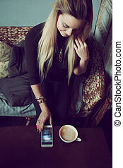 Young charming female freelancer chatting on mobile phone...