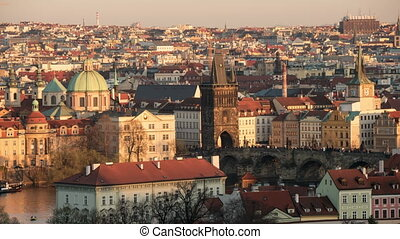 The Vltava river with gothic buildings on its embankments...