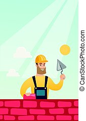 Bricklayer working with spatula and brick. - Young...