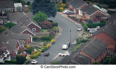 Cars Pass Through Houses In Residential Area - High angle...