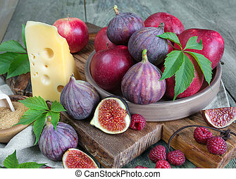 Summer Still Life with figs and cheese - Ripe figs, red...