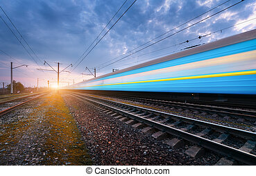High speed blue passenger train in motion