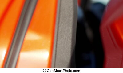 Sequence of video with man opening a car door and starting...