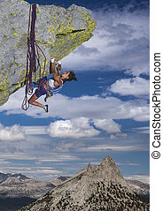 Climber on the edge. - Female climber struggeling up a sheer...