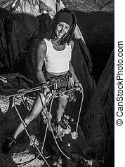 Climber on the edge. - Female climber belaying on the...